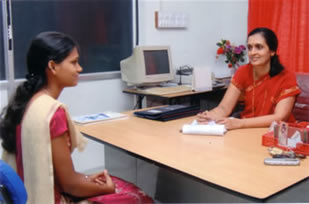 Mrs Rashmi S. Holla with a patient